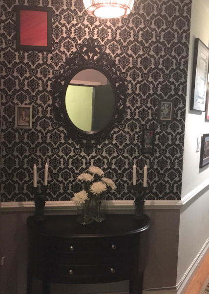 Entry with black and white vintage flock wallpaper
